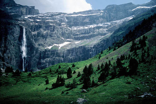 Photo of teh Pyrenees - Cirque de Gavarnie & Grande Cascade, 'Pyrénées-Mont Perdu'  (World Heritage Site)  Hautes Pyrénées / France.  This is the natural (though not very high or impregnable) boundary that blocks easy movement from France into Spain.  It was given over by imperial treachery during the Germanic Invasions of 409.